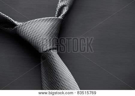 Man's tie on dark background