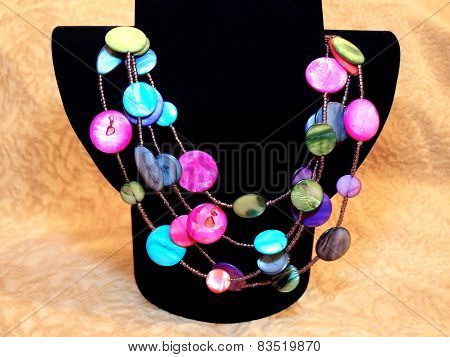 Beautiful  Colorful Beads Of Natural Nacre On Black Bust