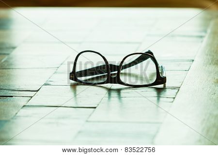 Pair Of Glasses On A Checkered Table