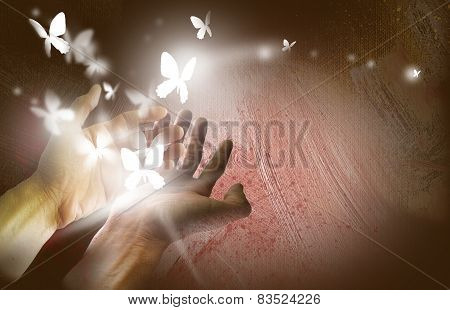 Butterflies set free by two hands