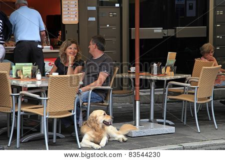 Nurnberg, Germany - July 13 2014: Hauptmarkt, The Central Square Of Nuremberg - Couple At Cafe With