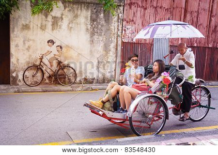 Malaysia, Penang, Georgetown - Circa Jul 2014: A Real Bicycle, Juxtaposed Over A Lifesize Mural Of A