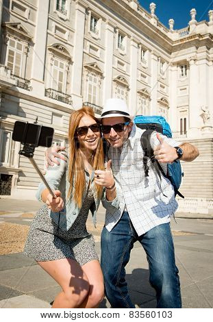 young beautiful friends tourist couple visiting Spain in holidays exchange students and taking selfie stick picture together in town happy on sunny day in travel and vacation concept poster