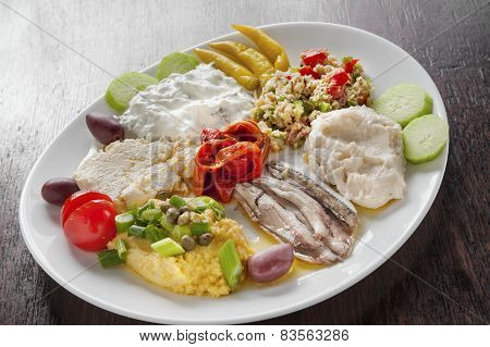 variety of Greek appetizers ouzo meze in dish poster