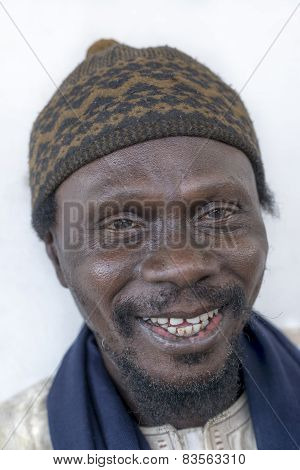 THIAROYE, SENEGAL, AFRICA - JULY 18, 2014 - Unidentified Muslim man sitting in front of the Mosque