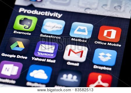 Close-up image of an iPhone screen with icons of productivity apps