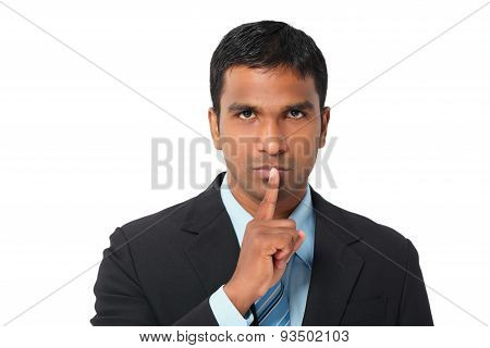 Portrait of businessman asking to keep silence poster