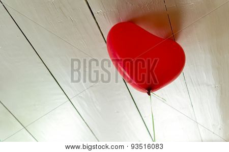 Single Red Balloon Trying To Escape