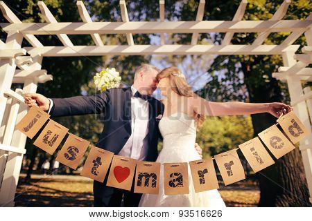 Couple Holding Just Married Signs