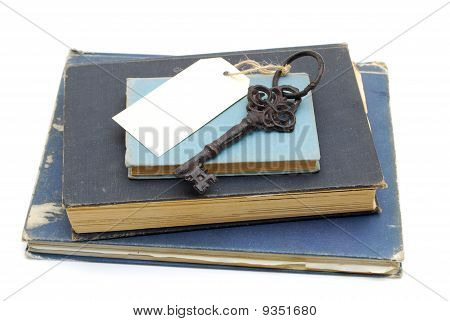 Key And Blank Card On Books