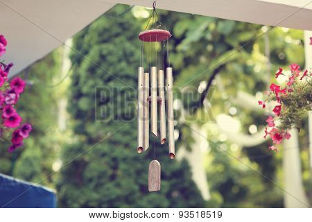 Capture of Silver and wood wind chimes poster