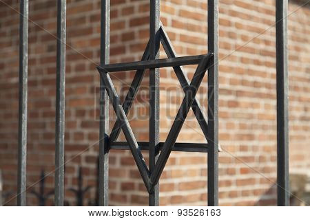 Star Of David On Metal Fence Of Old Synagogue In Cracow , Poland
