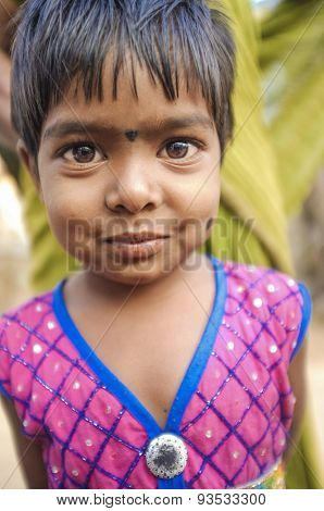 HAMPI, INDIA - 31 JANUARY 2015: Cute little Indian girl with bindi in dress on street