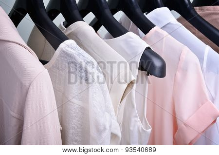 womens clothing pastel colors hanging on the hanger horizontal