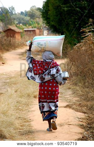 African Woman With A Sack Of Flour On His Head - Pomerini - Tanzania - Africa