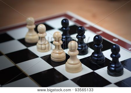 Confrontation of pawns on a chess board