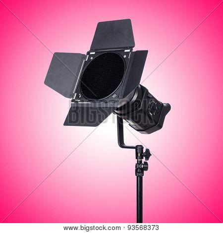 Studio light stand against the gradient