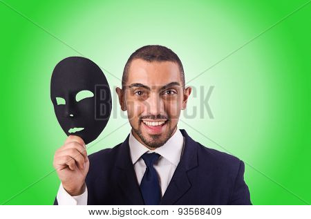 Man with mask against the gradient