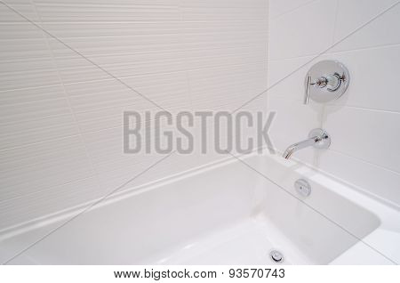 Fragment of luxury bathroom with a detail of bathtub.