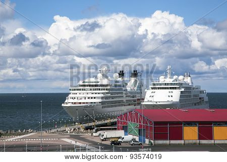 Two large cruise liners near moorage in Grand Marina