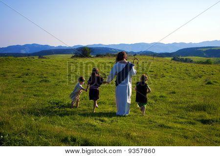 Jesus walking with children