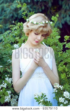 Beautiful Blonde Woman In White Sundress Posing In Garden