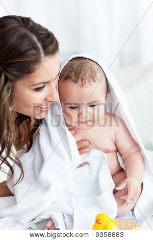 Delighted Mother Drying Her Baby After His Bath