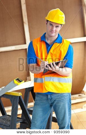 Confident Male Worker Holding A Clipboard