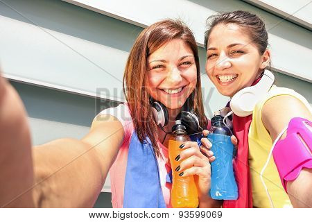 Sporty Girlfriends Taking Selfie During A Break At Sport Training In Urban Area - Young Happy Women