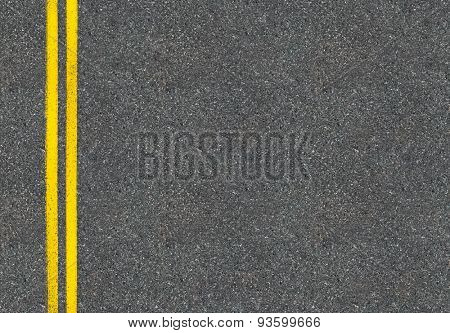 Asphalt road top view with two yellow lines