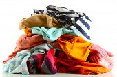 Heap of different clothes, isolated on white poster