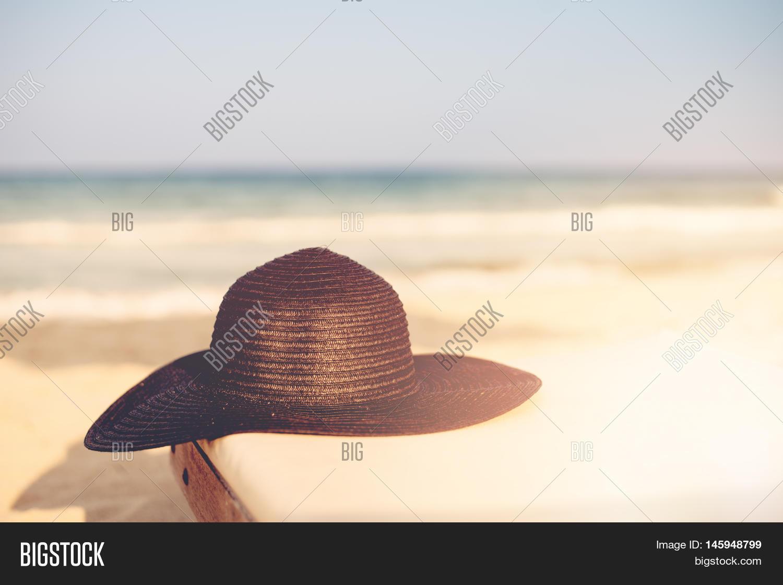 f37d33cf277 Black Hat On Beach Chair On The Tropical Sand Beach. Sun