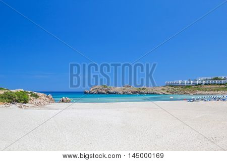 Arenal de Son Saura beach with white sand and turquoise Mediterranean sea in summer sunny day at Menorca island, Spain.