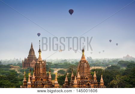 Bagan pagoda field in morning soft ligh with fog floating above Bagan pagoda sea in dreamlike misty morning in Mandaylay, Myanmar. Bagan is one of the most popular tourist destinations in Myanmar.