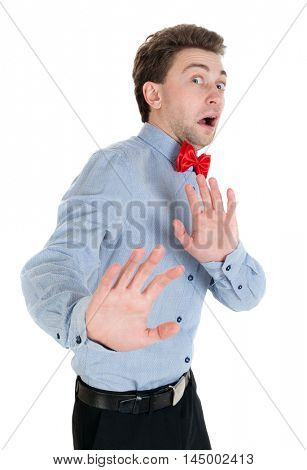 The guy in a shirt and bow tie locked arms experiencing negative emotions. Businessman in a shirt and a bow tie is protected by hands in fear.