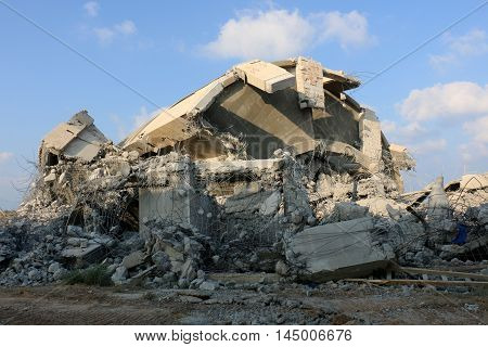 after a controlled explosion dropped the old, unfinished tower in the city of Acre