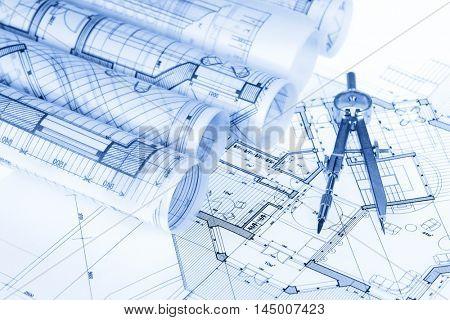 rolls of architecture blueprints, house plans &  compass