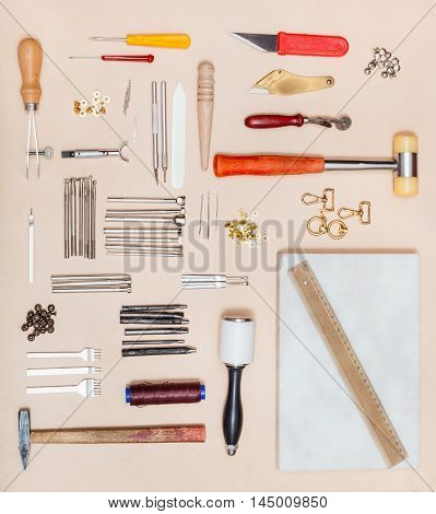 Top View Of Leatherwork Tools And Marble Board