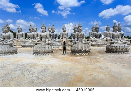 Thai people take a photo with Buddha statue and blue sky Nakhon Si Thammarat Province Thailand