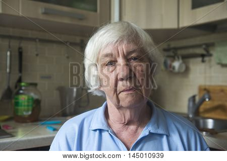 Portrait of a lonely old woman