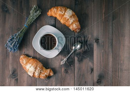 Continental Breakfast Background - Pair Of Croissants. Rustic Wooden Background With Place For Text.