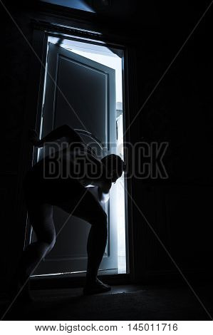Young Adult Man Peeping Through The Door