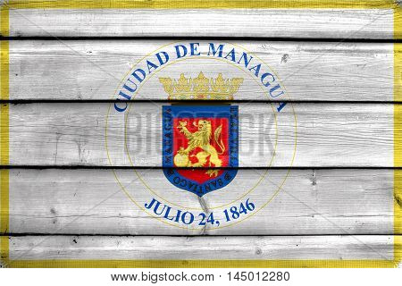 Flag Of Managua, Nicaragua, Painted On Old Wood Plank Background