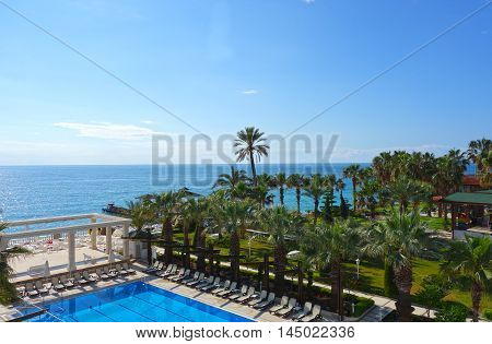 Beach hotel resort with swimming pool and garden in Antalya Turkey