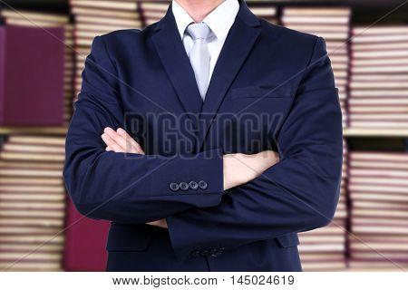 Businessman on blurred bookshelves background. Law concept.