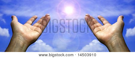 Two open hands in the sky with a sphere of light, symbol of gratefulness and gratitude.
