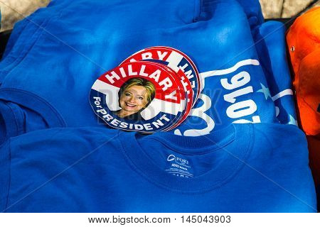 Lancaster PA - August 30 2016: Hillary Clinton 2016 stickers and tee shirts for sale at a rally for Virginia Senator Tim Kaine.