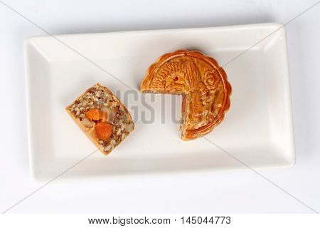 A dish of Mooncake filling five seed and salt eggs on white background.