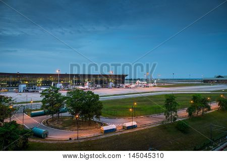 Kuala Lumpur, Malaysia - circa August 2016: View of KLIA, Kuala Lumpur International Airport, Malaysia, at dawn. KLIA is the biggest airport in Malaysia and is a major airport in Asia. The photo shows the exterior, runaway, airplanes towed in front of the