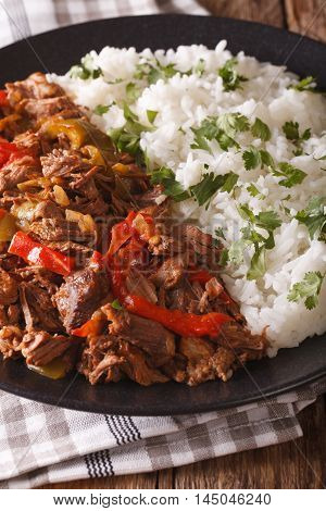Ropa Vieja: Beef Stew In Tomato Sauce With Vegetables And Rice Garnish Close-up. Vertical